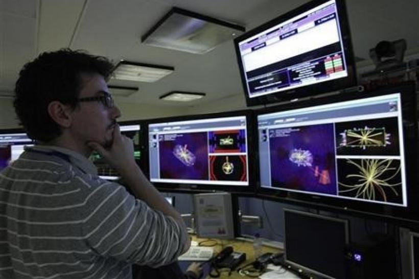 A scientist looks at the first collisions pictures at full power at the Compact Muon Solenoid (CMS) experience control room at the Large European Organisation for Nuclear Research (CERN) in Meyrin, near Geneva March 30, 2010.