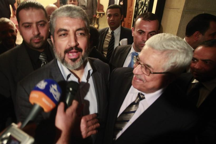 Hamas leader Meshaal and Palestinian President Abbas speak to the media after their meeting in Cairo