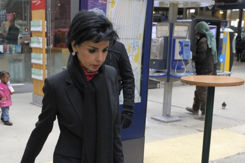 Former French Justice Minister Rachida Dati walks in the Gare du Nord train station to take a train for Lille.