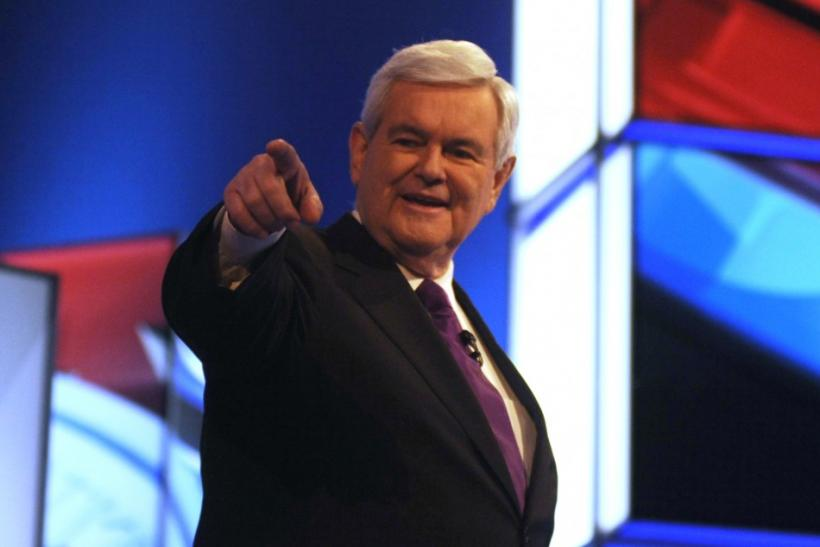 Republican U.S. presidential candidate Newt Gingrich points before the start of the presidential debate in Mesa, Arizona, February 22, 2012.