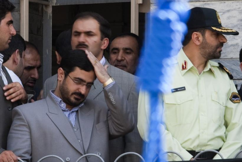 File photo shows Tehran Prosecutor General Saeed Mortazavi adjusting his hair as he attends an execution by hanging in Tehran