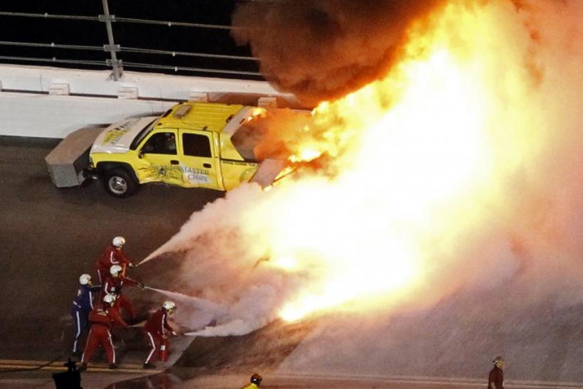 Flames erupt from a jet dryer after it was hit by Juan Pablo Montoya of Colombia in his number 42 Chevrolet during the NASCAR Sprint Cup Series 54th Daytona 500 race at the Daytona International Speedway in Daytona Beach