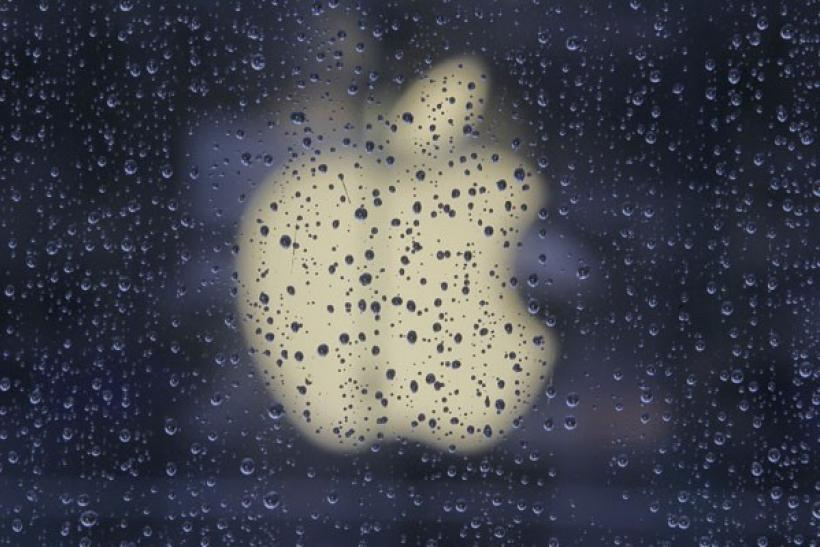 Raindrops are seen in front of an Apple logo outside an Apple store in Shanghai