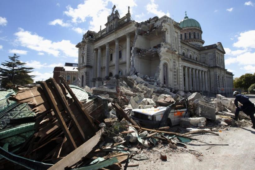 A rescue worker looking through the rubble of the Cathedral of Blessed Sacrament in Christchurch.