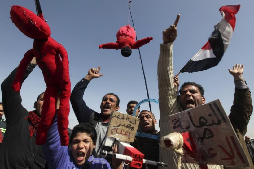 Relatives of victims killed during the revolution shout slogans against former Egyptian president Mubarak and Field Marshal Tantawi in Cairo.