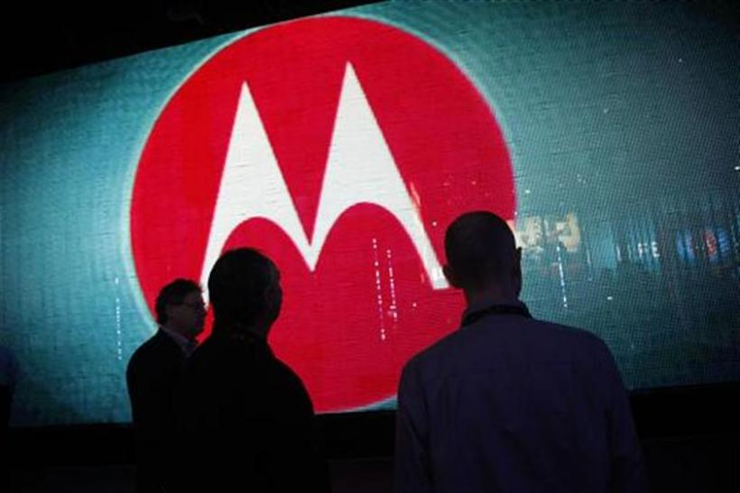 Visitors look at a video display at the Motorola booth on the second day of the Consumer Electronics Show (CES) in Las Vegas