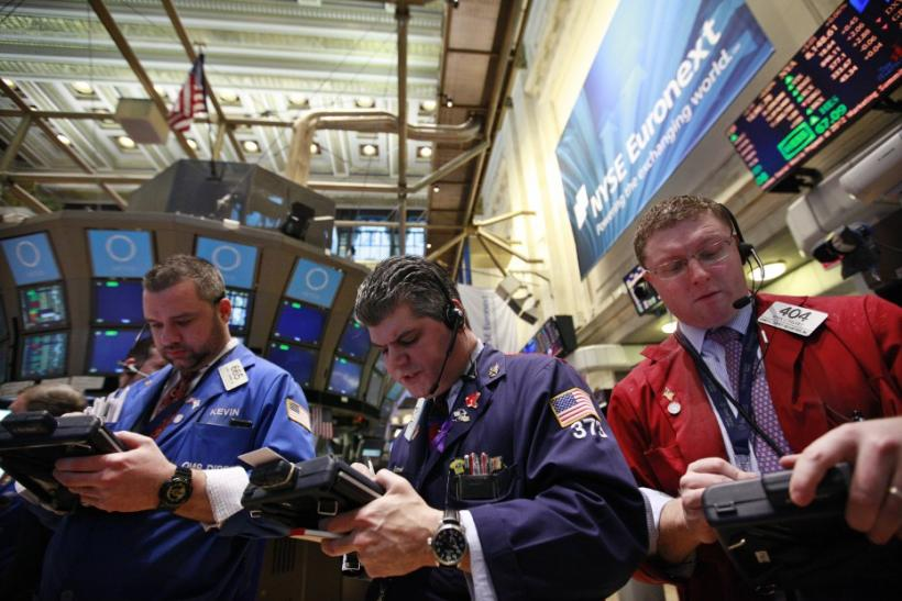 Traders work on the floor of the New York Stock Exchange, February 28, 2012.