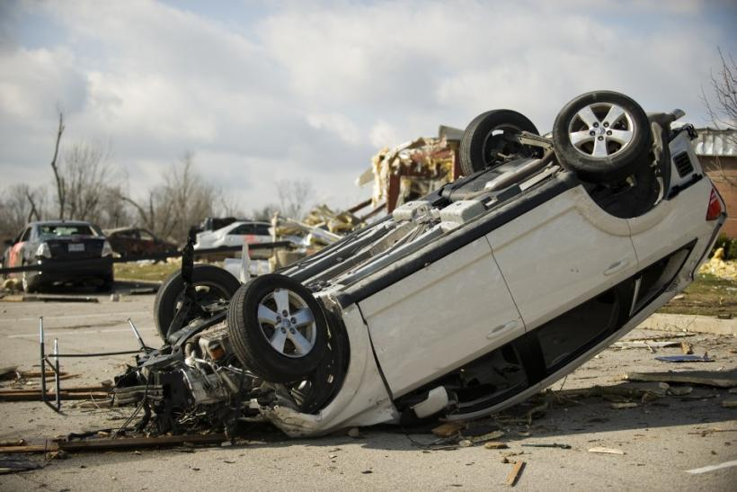 Courtesy of the Indiana National Guard, a handout photo shows a vehicle flipped over by a tornado in Henryville, Ind., March 3, 2012.