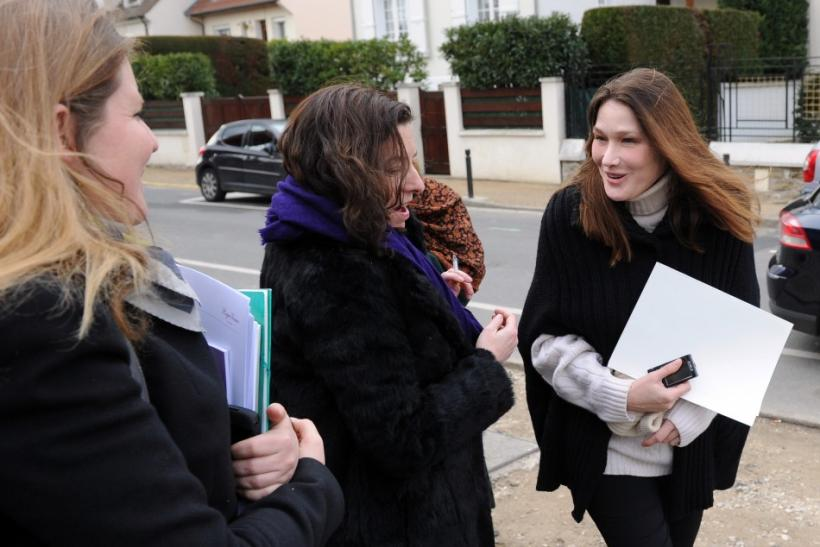 Carla Bruni-Sarkozy Visits Disabled Children at a Motor Rehabilitation Center