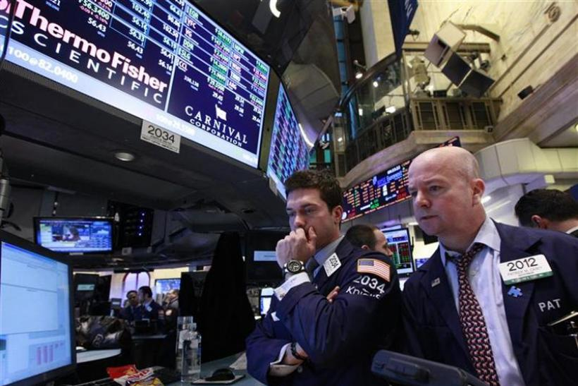 Specialist trader Joseph Dreyer of Knight Capital works at the post that trades Carnival Cruise lines on the floor of the New York Stock Exchange