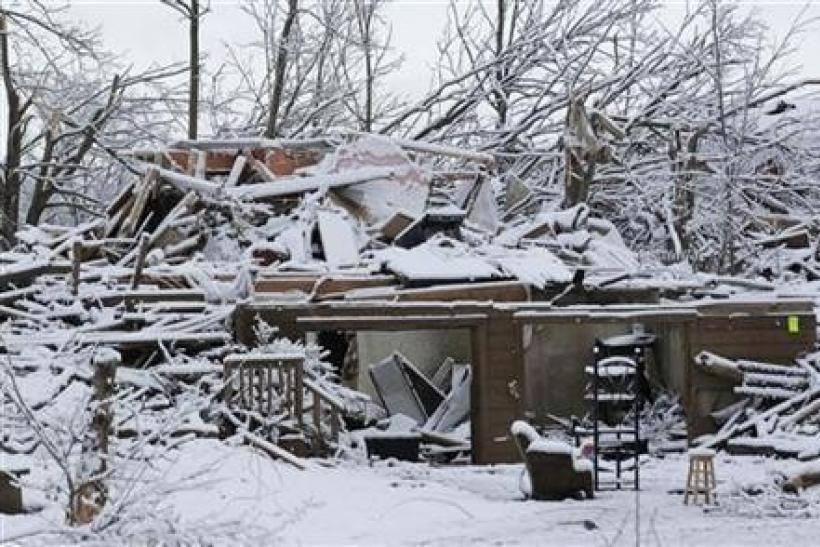 Snow covers a storm-damaged home in Henryville, Indiana, March 5, 2012.