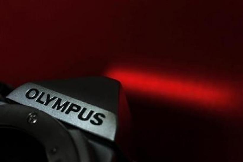 The Olympus logo on its camera is seen in this illustrative photograph taken in Tokyo November 24, 2011.