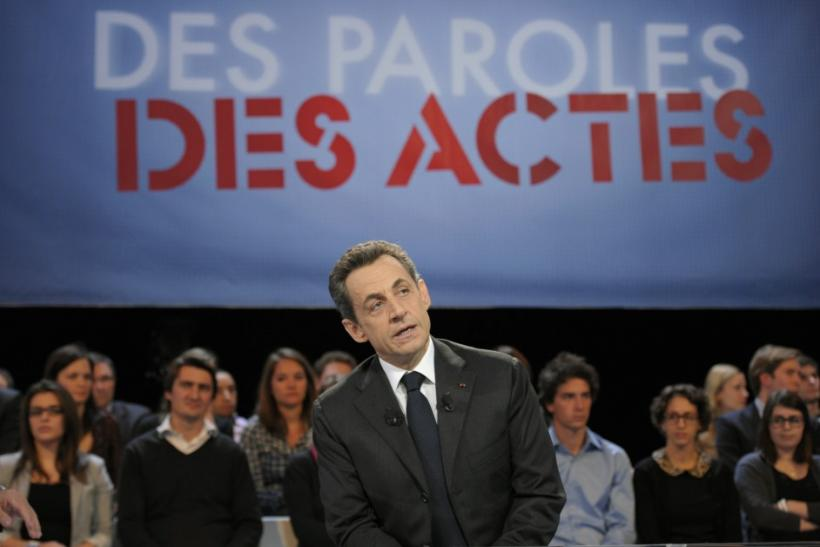 France's President Nicolas Sarkozy speaks during an interview on French national television in Paris.