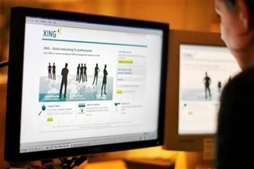 A web-user views the global networking site called Xing in Stockholm, November 20, 2008