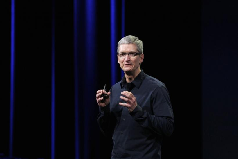 Apple CEO Cook speaks on stage during an Apple event introducing the new iPad in San Francisco