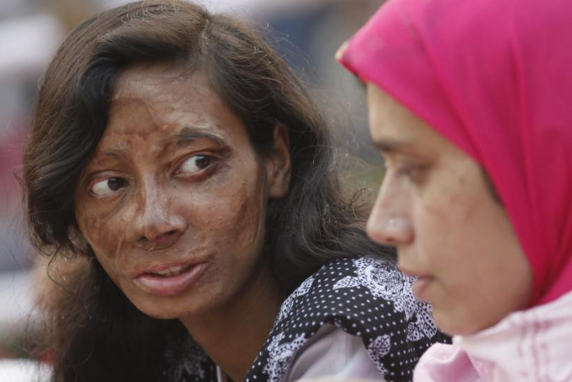 Survivor of acid attack takes part in an awareness rally about the violence against women in Dhaka