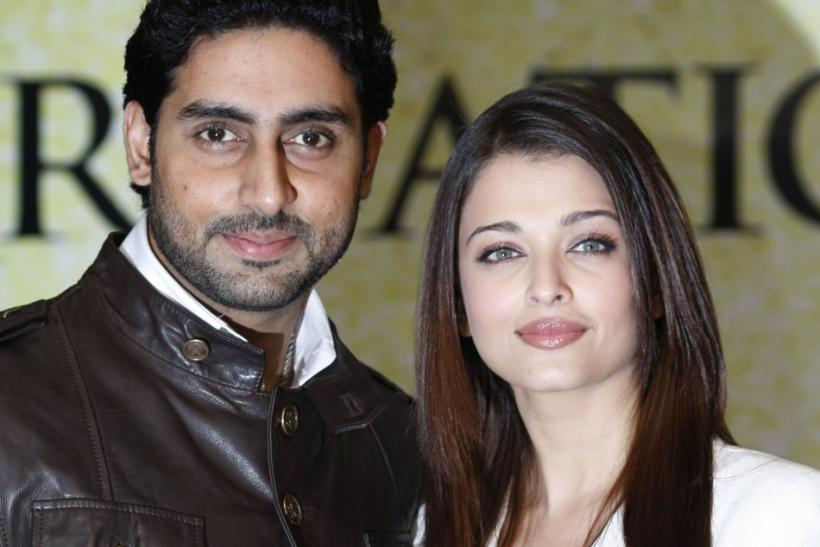 Actors Abhishek Bachchan and wife Aishwarya Rai Bachchan pose during a photocall in London