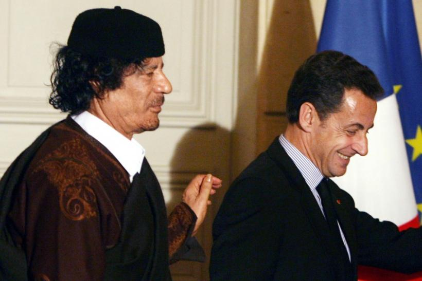 France's President Nicolas Sarkozy and Libyan leader Muammar Gaddafi leave the room after the signature of trade contracts in Paris in Dec. 2007.