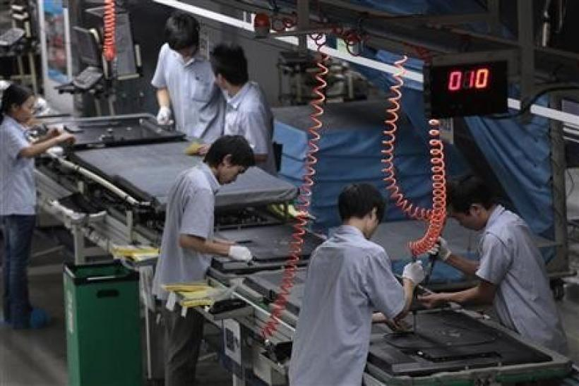 TCL Multimedia employees work at a production line in a factory in Huizhou, in China's southern Guangdong province October 8, 2010.