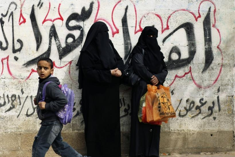 Palestinian women watch funeral of Islamic Jihad militant Mohammed Daher in Gaza City