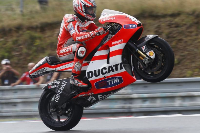 Ducati MotoGP rider Hayden of the U.S. performs a wheelie.