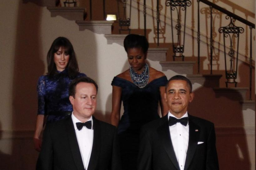 U.S. President Barack Obama (front R) and and first lady Michelle (back R) welcome British Prime Minister David Cameron and his wife Samantha to the White House for the State Dinner in Washington March 14, 2012.