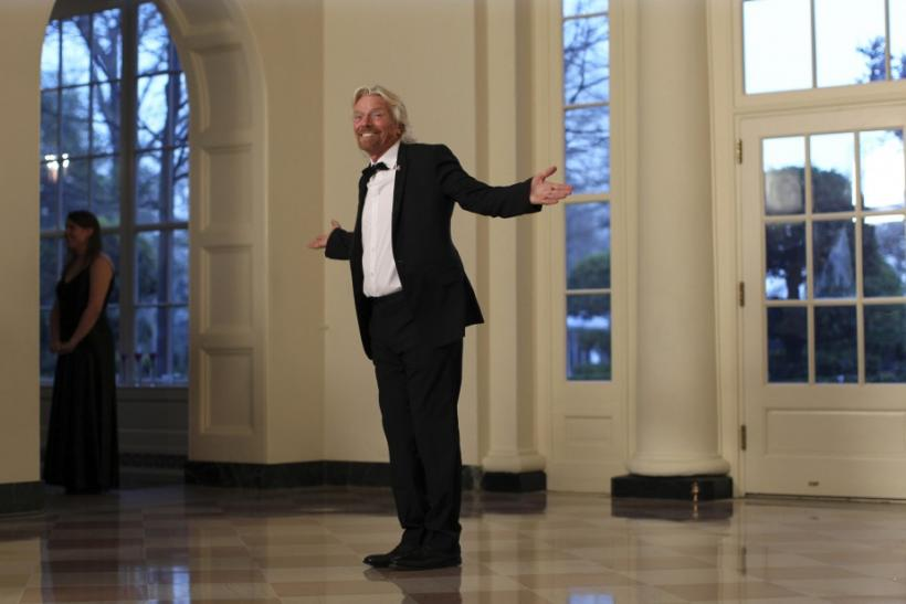 British billionaire Richard Branson arrives for a State Dinner held in honor of Britain's Prime Minister David Cameron and his wife Samantha at the White House in Washington March 14, 2012.