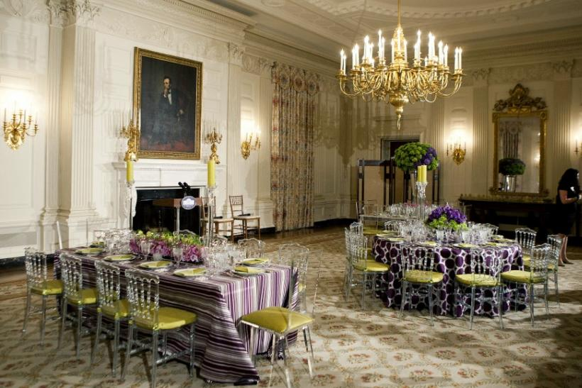 A table setting for the State Dinner with U.S. President Barack Obama and Britain Prime Minister David Cameron, is shown during a preview in the State Dining Room at the White House in Washington March 14, 2012.