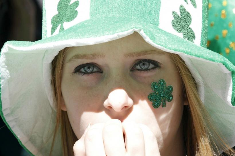 A young woman watches the New York City's 250th annual St. Patrick's Day parade, March 17, 2011.