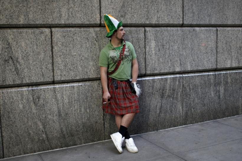 A man in a kilt pauses against a wall along 5th Avenue in New York during the city's 250th annual St. Patrick's Day parade, March 17, 2011.