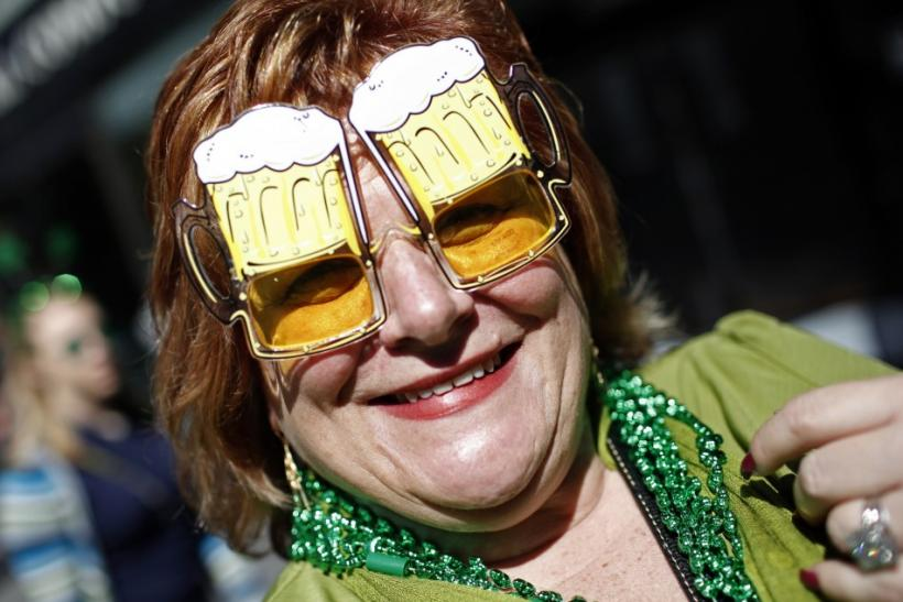 A woman wears beer mug glasses as she joins thousands of revellers celebrating along 5th Avenue in New York during the city's 250th annual St. Patrick's Day parade, March 17, 2011.