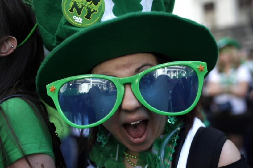 A woman wears giant sunglasses as she celebrates with thousands along 5th Avenue in New York during the city's 250th annual St. Patrick's Day parade, March 17, 2011.