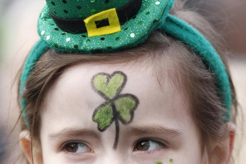 A young girl with her face painted watches the annual St. Patrick's Day parade in Belfast, Northern Ireland March 17, 2011.