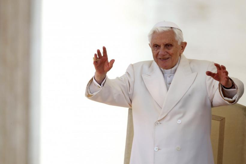 Pope Benedict XVI waves during his Wednesday general audience in Saint Peter's Square at the Vatican
