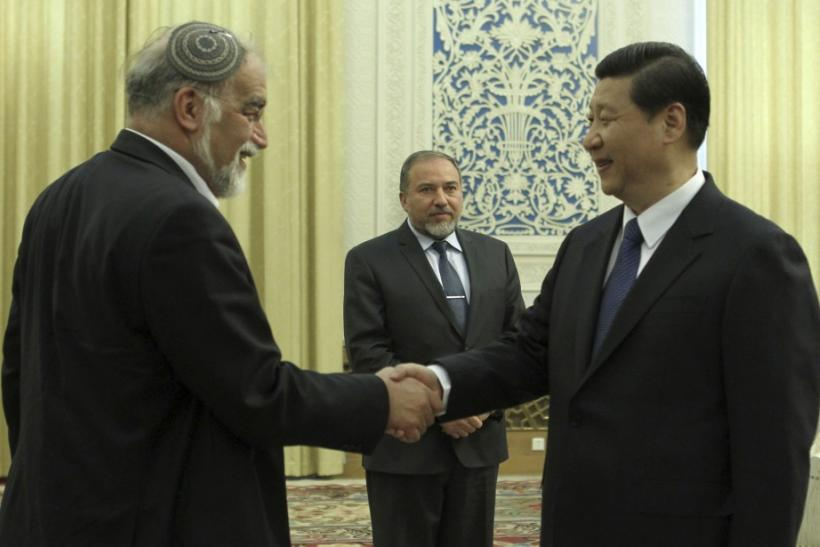Israel's Foreign Minister Avigdor Lieberman looks on as China's Vice President Xi Jinping shakes hands with an Israeli official at the Great Hall of the People in Beijing