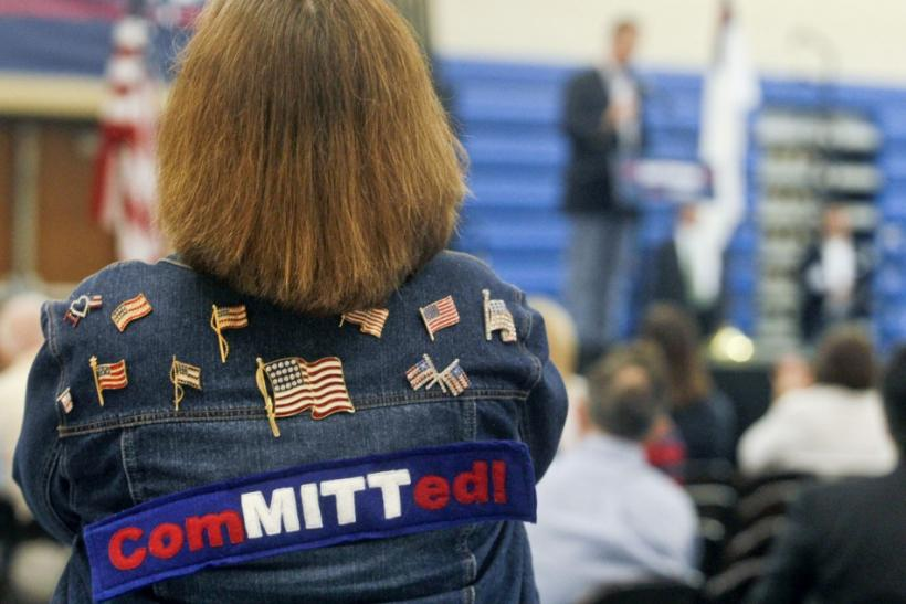 A Mitt Romney supporter listens as U.S. Republican presidential candidate Rick Santorum speaks during an event at Westminster Christian Academy in Town and Country, Missouri, March 17, 2012, the day of the Missouri Republican Caucuses.