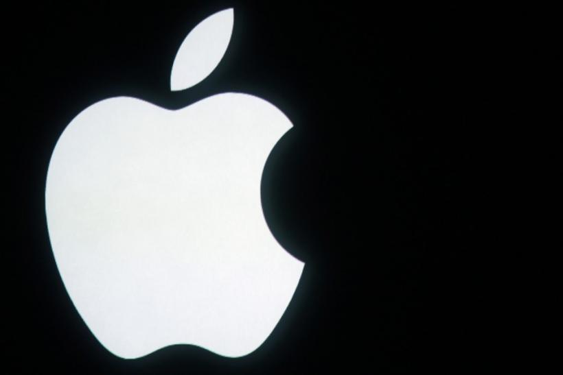 The Apple logo is displayed onstage before a product unveiling event at Apple headquarters in Cupertino, California October 4, 2011.