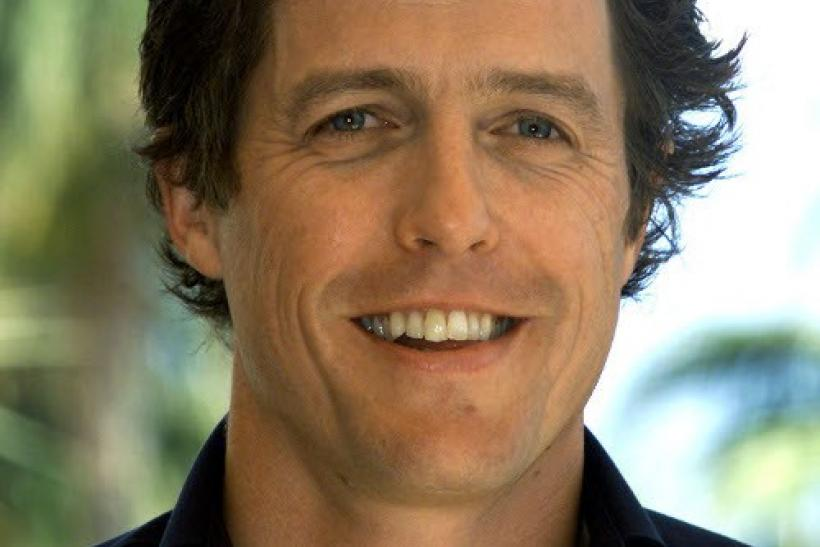 British actor Hugh Grant poses for photographers during a photocall in Cannes May 25, 2002.