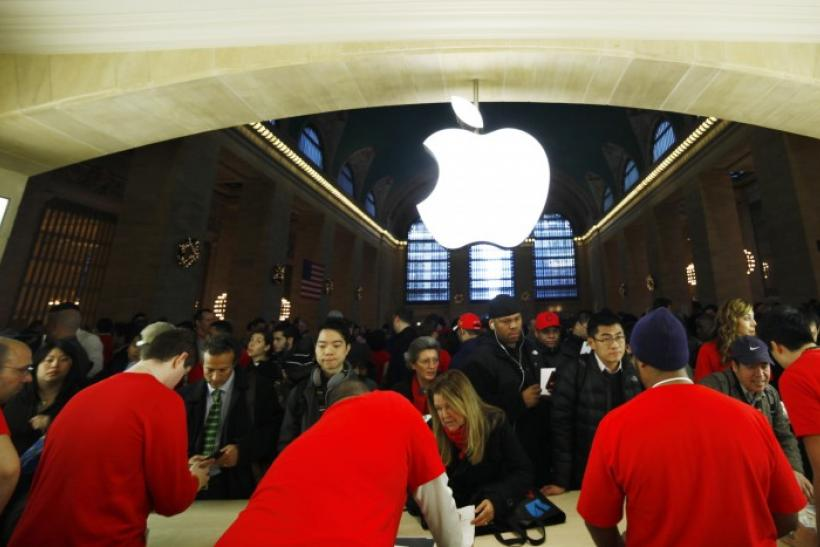 Customers buy Apple products inside the newest Apple Store during its opening on the East Balcony in the main lobby of New York City's Grand Central Station