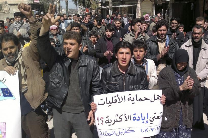Demonstrators protest against Syria's President Bashar Al-Assad in Kafranbel near Idlib.