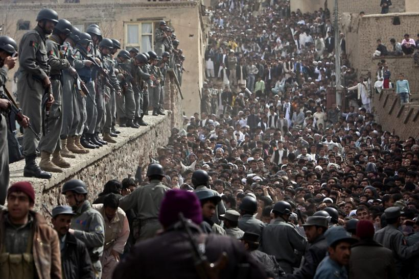 Afghan police control the crowd during the celebration of the Afghan New Year (Nawruz) in Kabul March 21, 2010. Afghanistan uses the Persian calendar, which runs from the vernal equinox. The calendar takes as its start date the time when the Prophet Moham