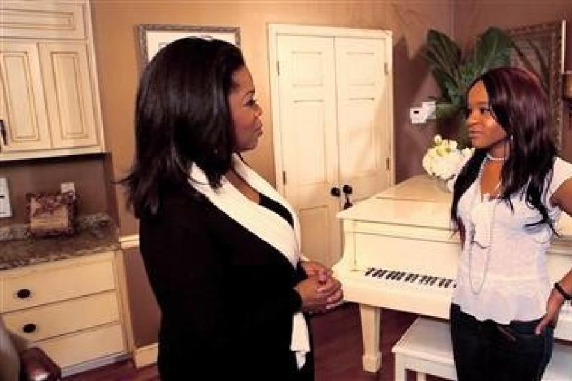 Oprah Winfrey (L) talks to Bobbi Kristina Brown, daughter of the late singer Whitney Houston