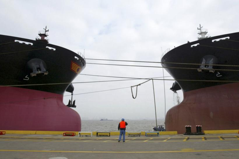 Two Capesize bulkers anchored in a Shanghai port