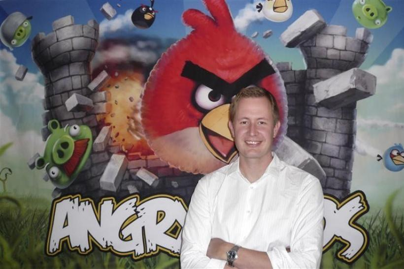 Rovio Chief Executive Mikael Hed stands in front of an Angry Birds poster at his company's offices in Helsinki August 16, 2010.