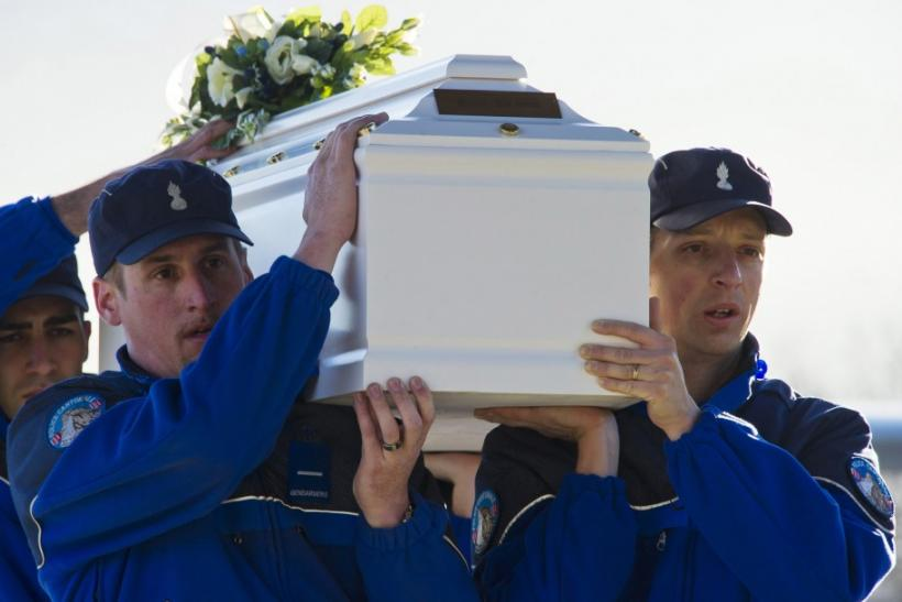 Police officers carrying coffin of a victim of Swiss bus crash