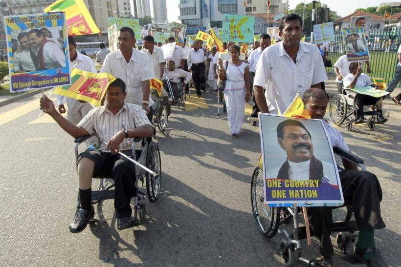 Handicapped Sri Lankan soldiers in wheelchairs call for the defeat of a U.N. resolution urging Sri Lanka to probe wartime human rights abuses in Colombo