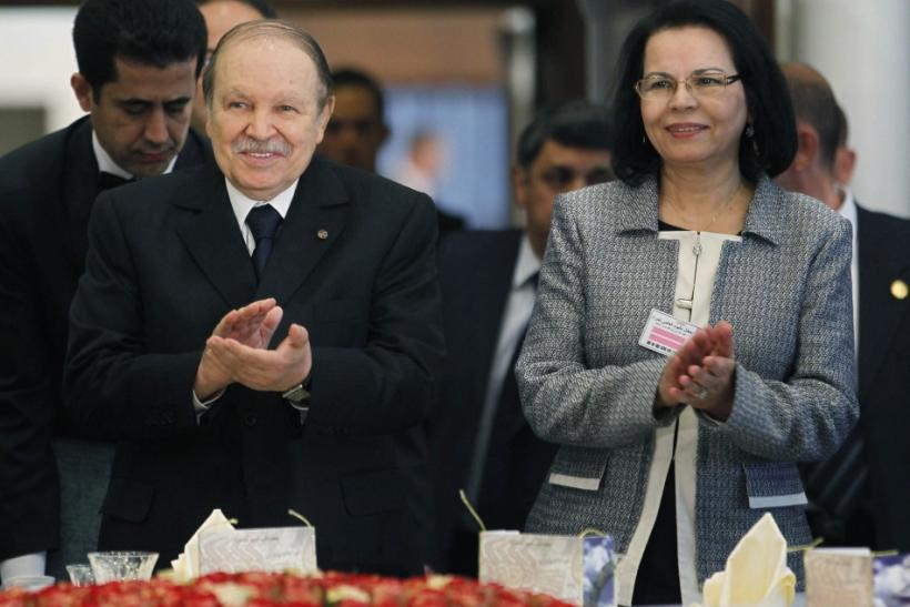 Algeria's President Bouteflika and Family and Women's Affairs Minister Djaffar welcome guests during a ceremony marking International Women's Day in Algiers