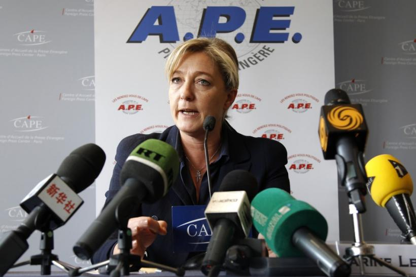 Marine Le Pen, France's National Front head and far right candidate for 2012 French presidential election, attends a press conference at the CAPE in Paris