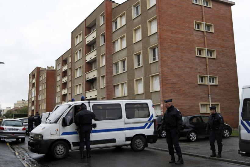 Police secure the street outside the five-storey apartment building where earlier special forces police staged the assault on the gunman Mohamed Merah in Toulouse