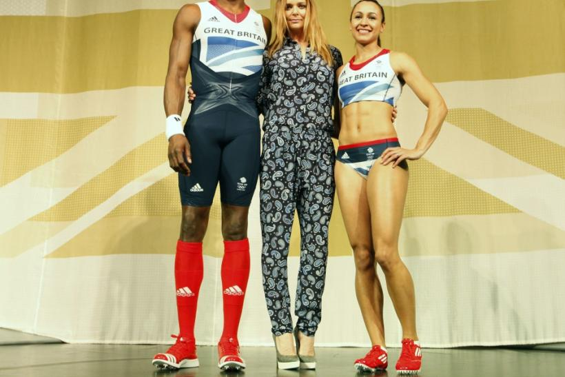 Triple jumper Phillips Idowu (L) and heptathlete Jessica Ennis pose wearing the new Team GB kits designed by British designer Stella McCartney (C) for the London 2012 Olympic Games, at a media viewing in London March 22, 2012.